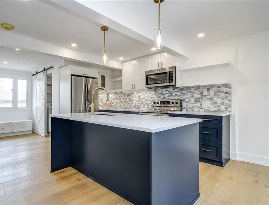 Two tone cabinetry; where dark and light tones are mixed to add character.